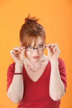 Woman glasses doubts