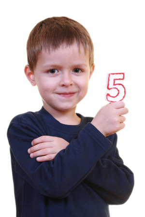 Boy_holding_number_five